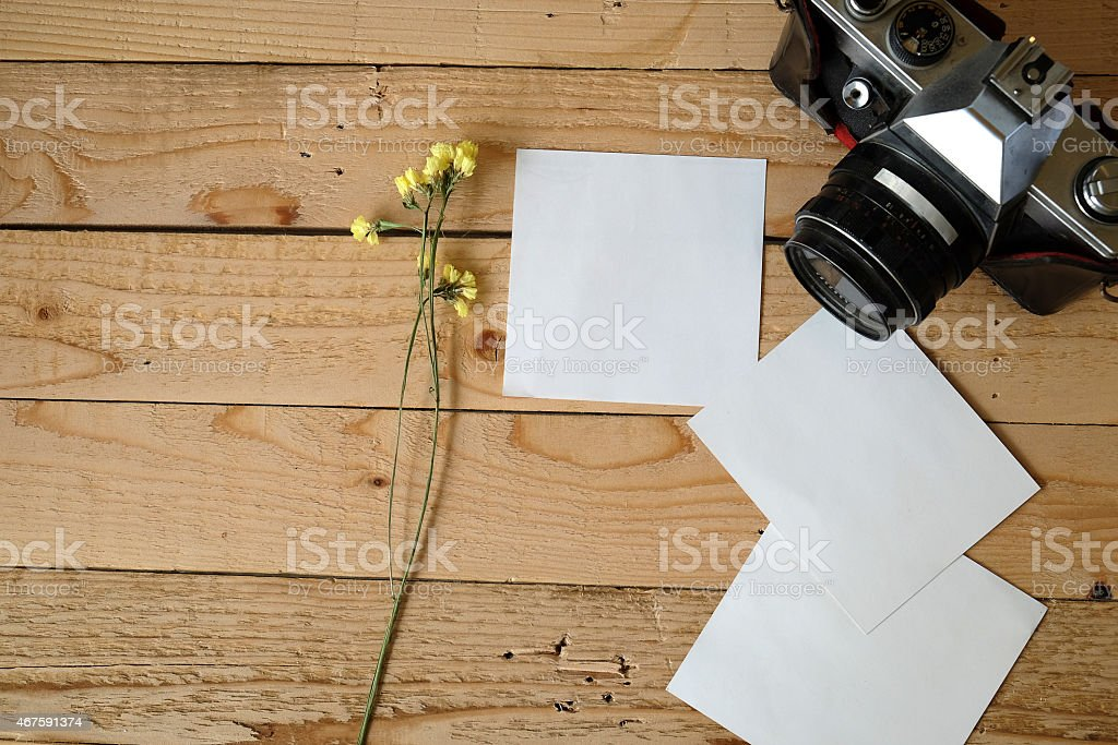 paper notes or photoframes with vintage camera stock photo