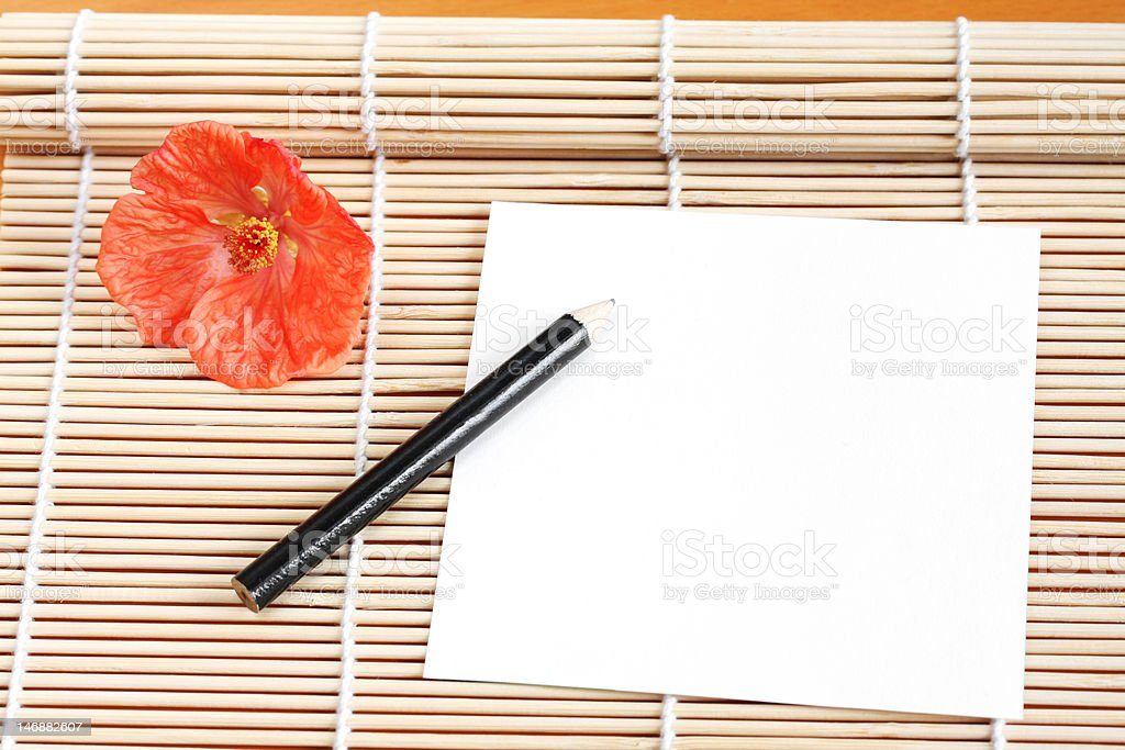 Paper on Bamboo Mat royalty-free stock photo