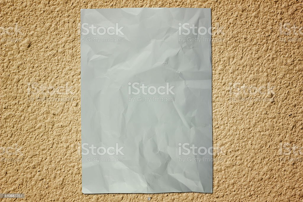Paper on cement wall stock photo
