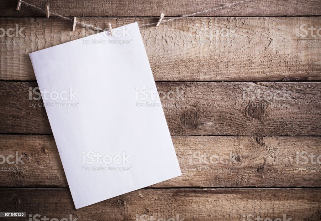 paper on old wooden background stock photo