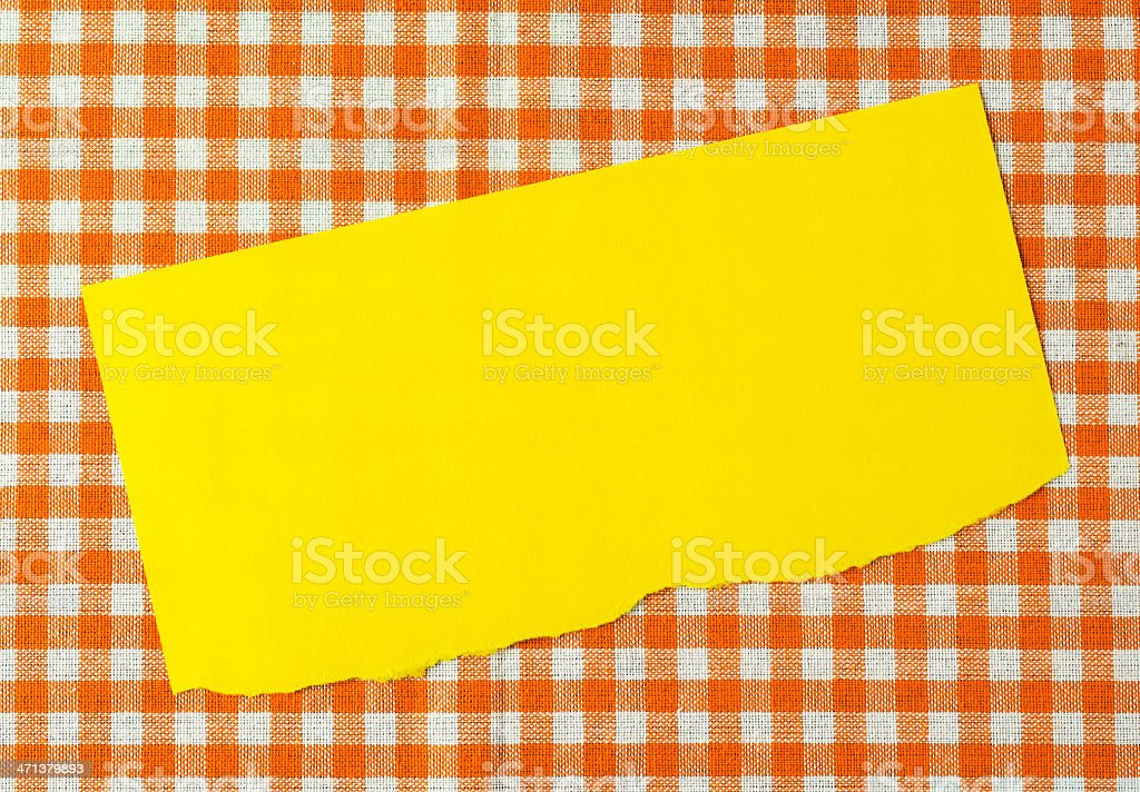 Paper on orange tablecloth royalty-free stock photo