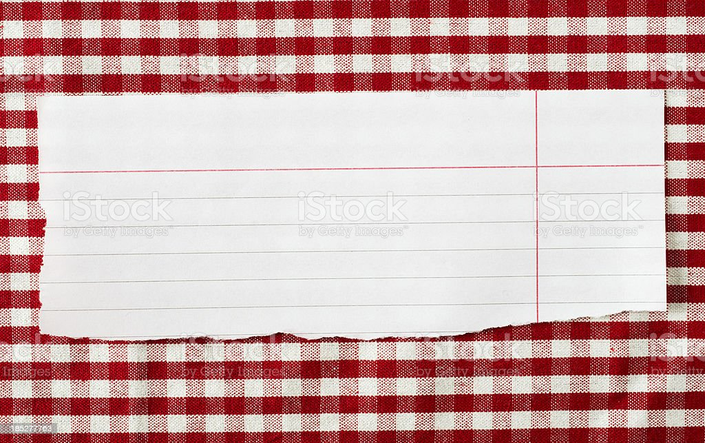 Paper on red tableclot royalty-free stock photo