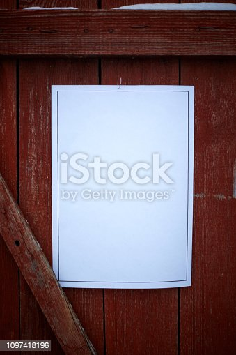 924754302 istock photo paper on red wood wall 1097418196