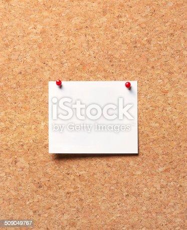 990092558 istock photo paper on the cork board 509049767