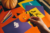 istock paper orange pumpkin on the background Halloween composition 612853446