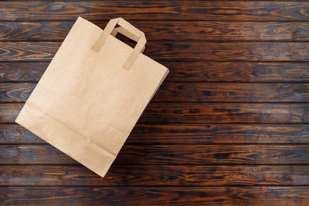 Paper package, wooden background, supermarket, products, purchas stock photo