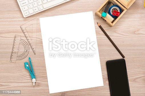 istock paper, pencil, ruler, smart phone on wooden desk 1175444988