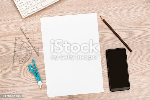 istock paper, pencil, ruler, smart phone on wooden desk 1175445194
