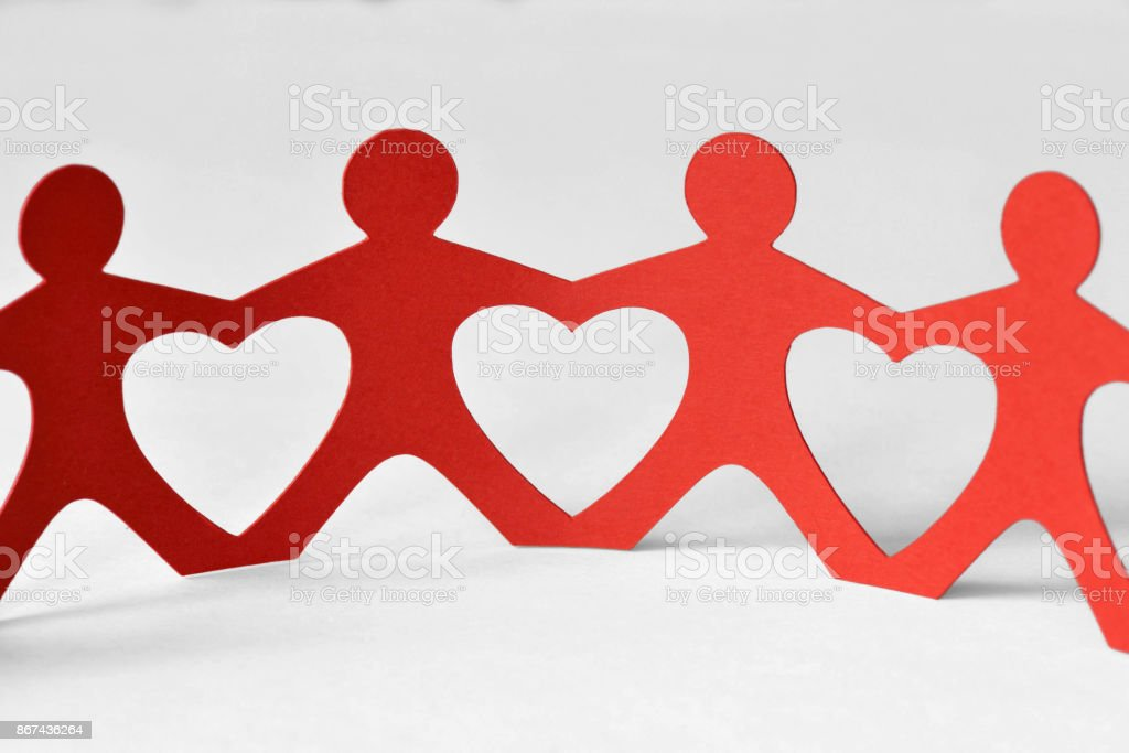 Paper people chain - Unity and love concept stock photo