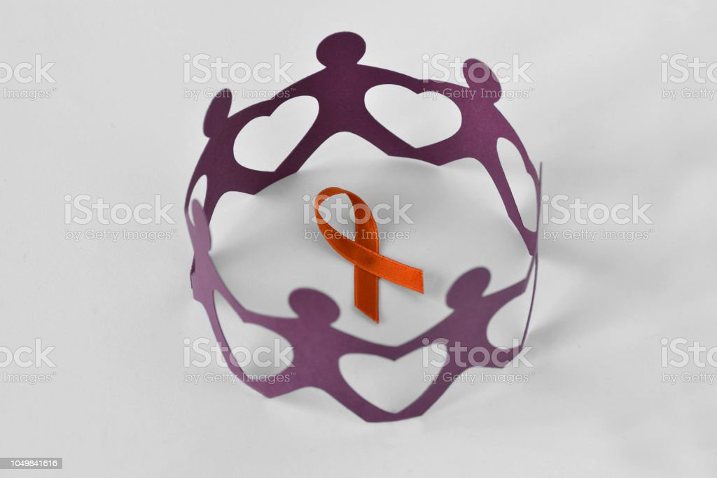 Paper people in a circle around orange ribbon on white background - Concept of leukemia awareness, kidney cancer association, multiple sclerosis and animal abuse stock photo