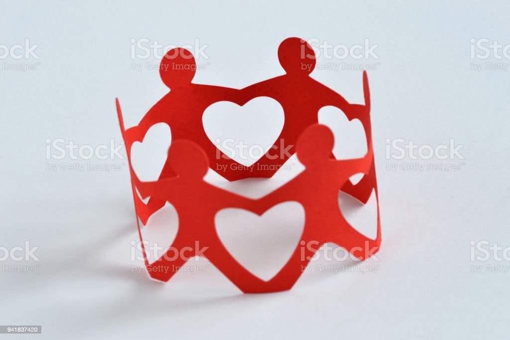 Paper people in a circle holding hands - Teamwork and love concept stock photo