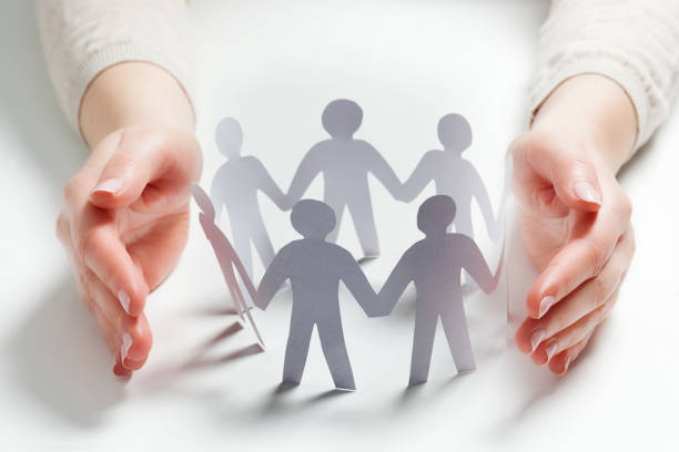 Paper people surrounded by hands in gesture of protection concept of picture id804432022?b=1&k=6&m=804432022&s=612x612&w=0&h=iqtautaw5uguwm0zmiweeiupw2kfpw6kazcecel99 0=