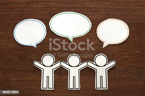istock Paper people with colorful blank dialog speech bubbles.  Communication concept. 966813894