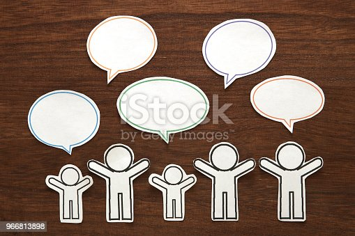 istock Paper people with colorful blank dialog speech bubbles.  Communication concept. 966813898