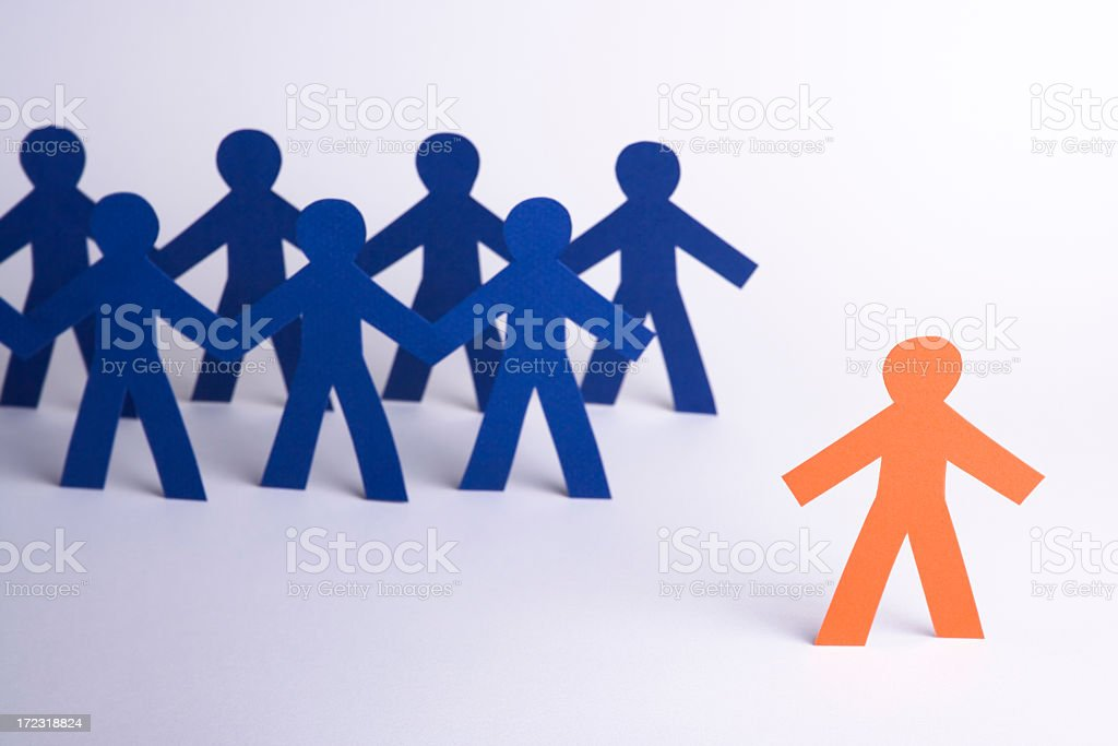 A paper person set apart from the group royalty-free stock photo