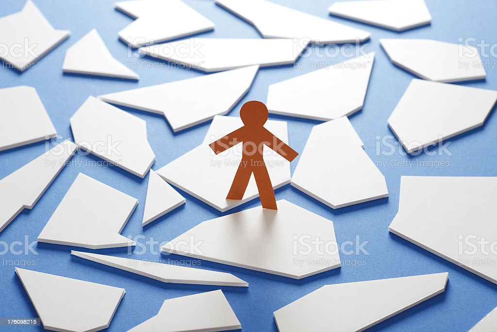 Paper person standing on ice floes royalty-free stock photo