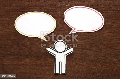 istock Paper person with colorful blank dialog speech bubbles.  Communication concept. 964119232