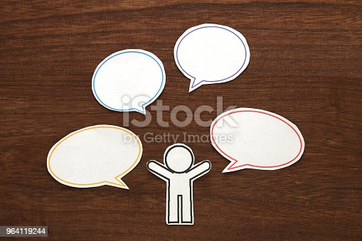 istock Paper person with colorful blank dialog speech bubbles.  Communication concept. 964119244
