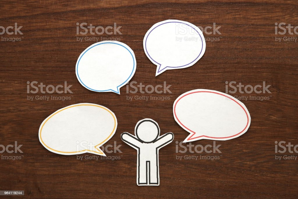Paper person with colorful blank dialog speech bubbles.  Communication concept. stock photo