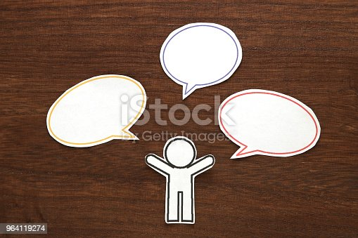 istock Paper person with colorful blank dialog speech bubbles.  Communication concept. 964119274
