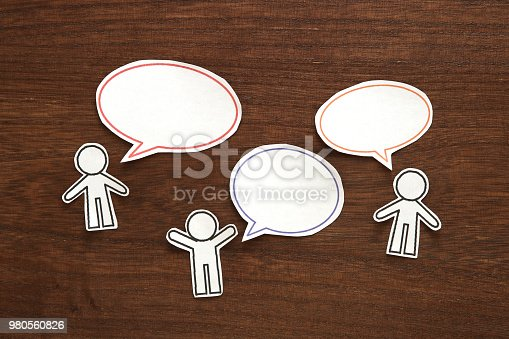 istock Paper person with colorful blank dialog speech bubbles.  Communication concept. 980560826
