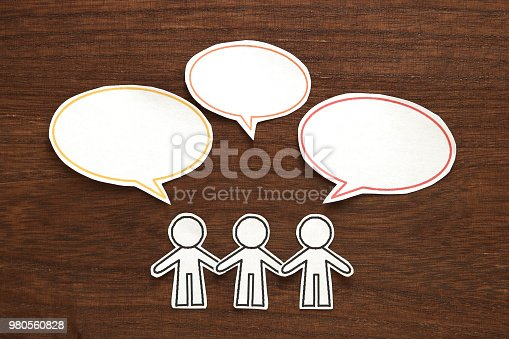 istock Paper person with colorful blank dialog speech bubbles.  Communication concept. 980560828