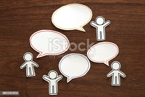 istock Paper person with colorful blank dialog speech bubbles.  Communication concept. 980560830