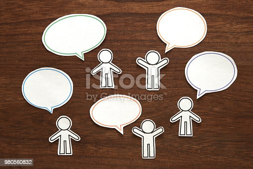 istock Paper person with colorful blank dialog speech bubbles.  Communication concept. 980560832