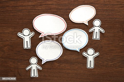 istock Paper person with colorful blank dialog speech bubbles.  Communication concept. 980560856