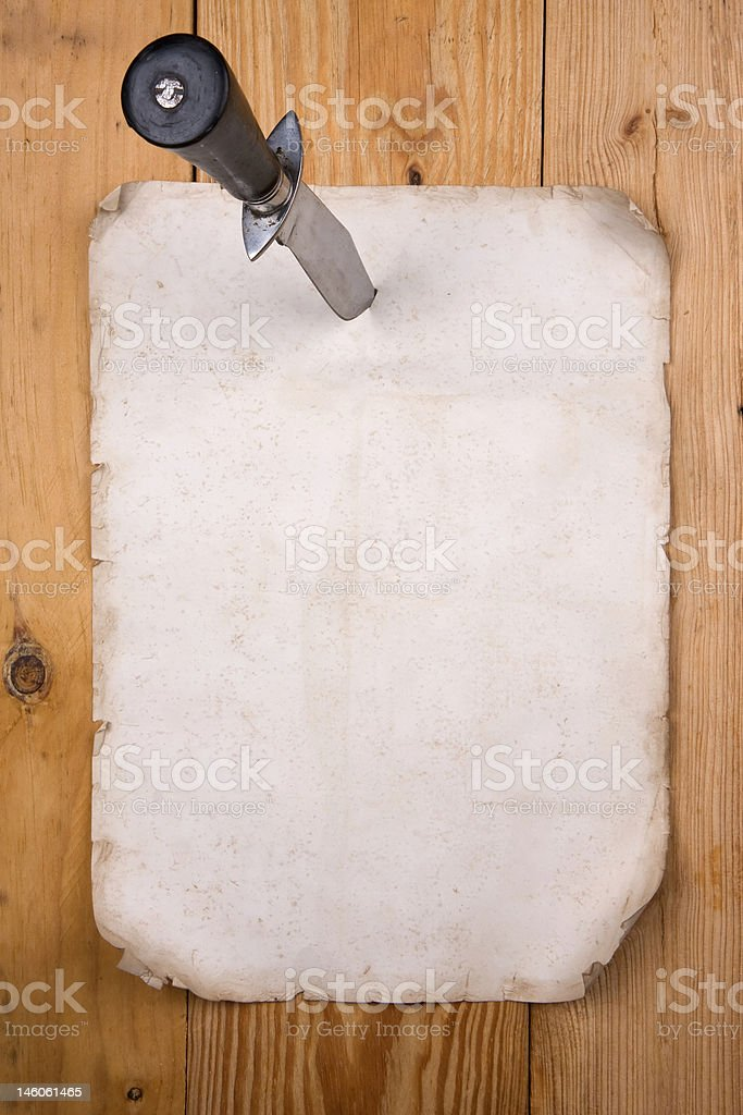 Paper pinned with a knife stock photo