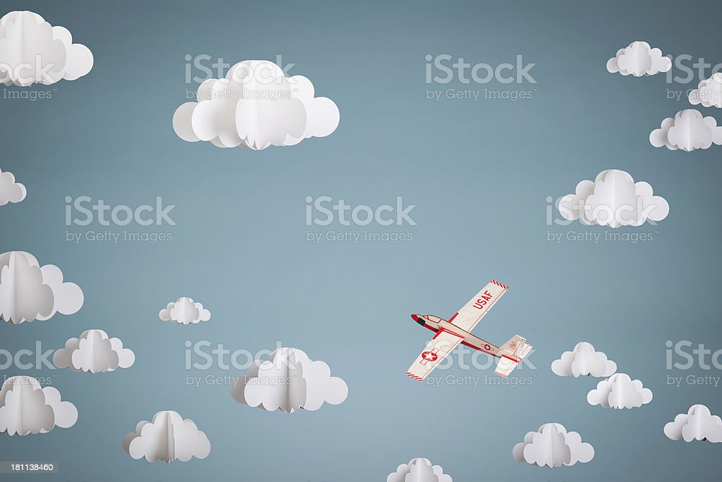 Paper Plane against 3D Clouds stock photo