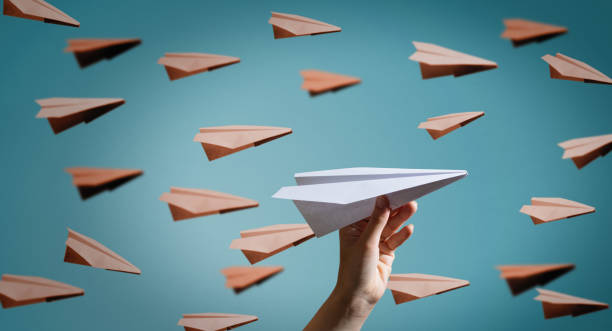Paper plane on blue background. stock photo