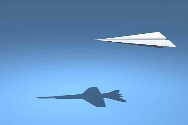 f18 paper plane - illusion stock photos and pictures