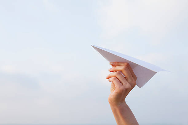 paper plane ready to fly - paper airplane stock photos and pictures