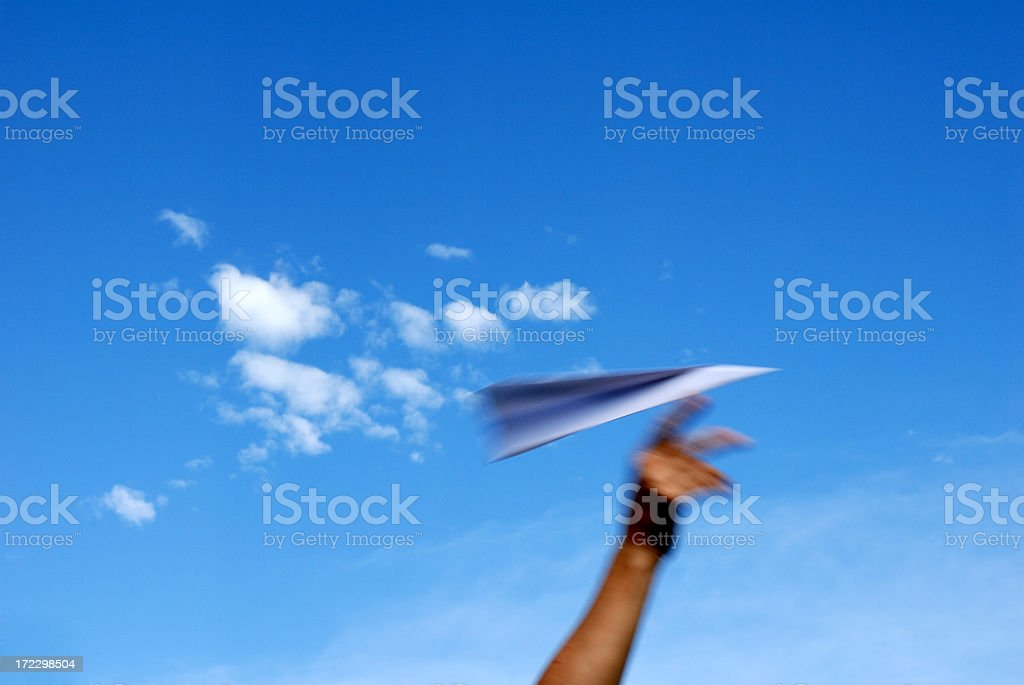 A paper plane soaring through the sky royalty-free stock photo