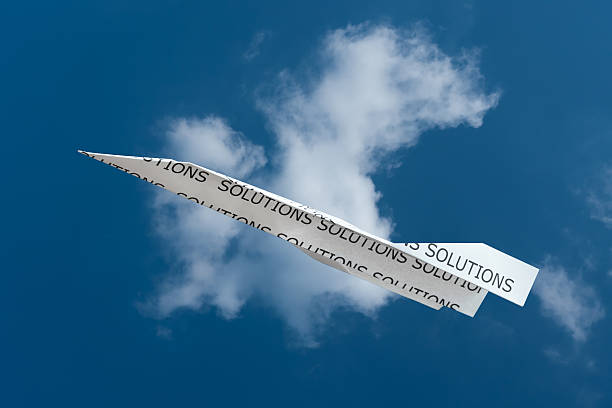 Paper plane Solutions stock photo