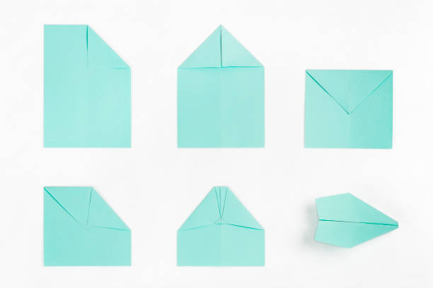 paper plane steps stock photo