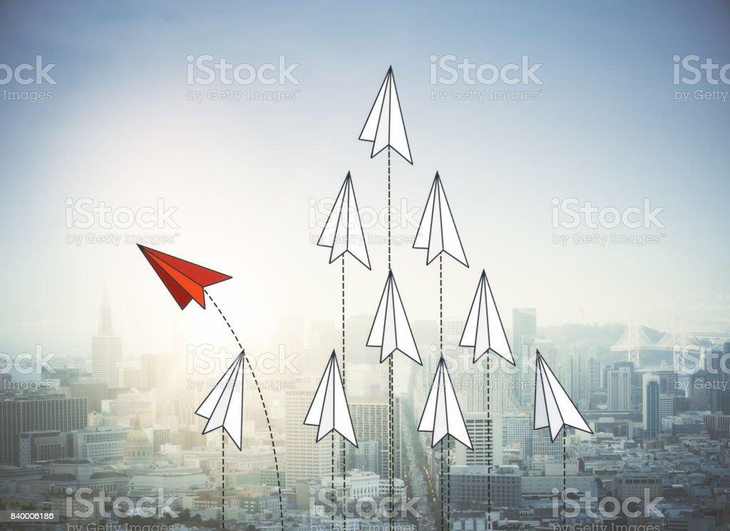 Paper planes on city bakcground stock photo