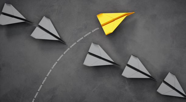 Paper planes - Thinking concept differently - Changing course - new ideas stock photo