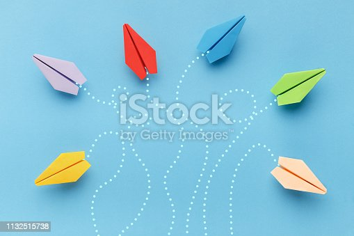 Business competition, different vision, creative and innovative solution concepts. Paper planes with route trace on blue background