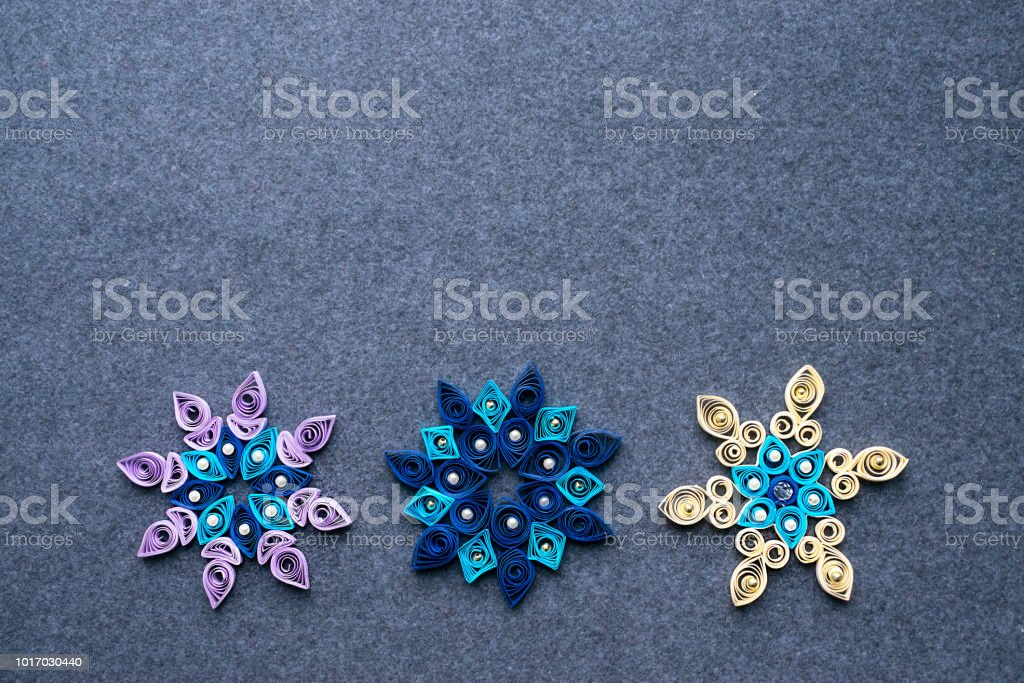 Paper Quilling Christmas Crafts In The Form Of Snowflakes From
