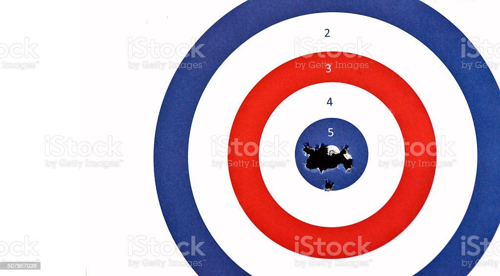 Paper Rifle target shot through the bullseye. stock photo