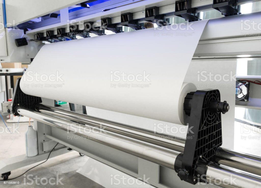 Paper roll in large printer format inkjet machine for industrial...
