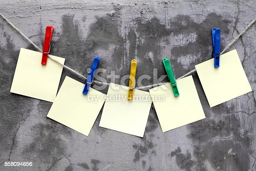 istock Paper sheets on a rope 858094656