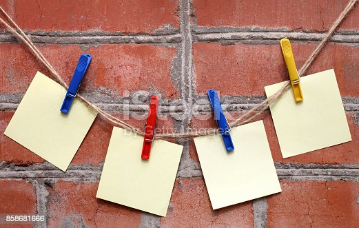 istock Paper sheets on a rope 858681666