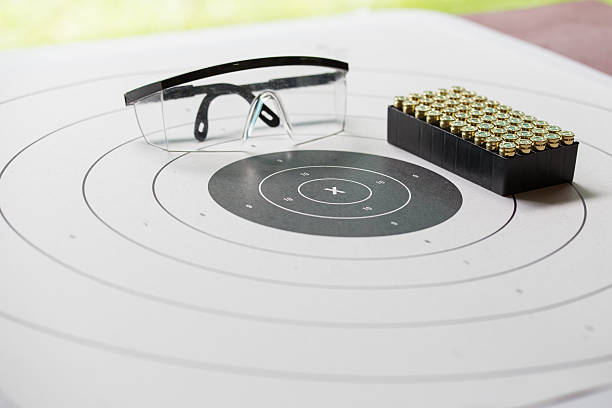 paper shooting target with safety glasses and 9 mm bullet – Foto