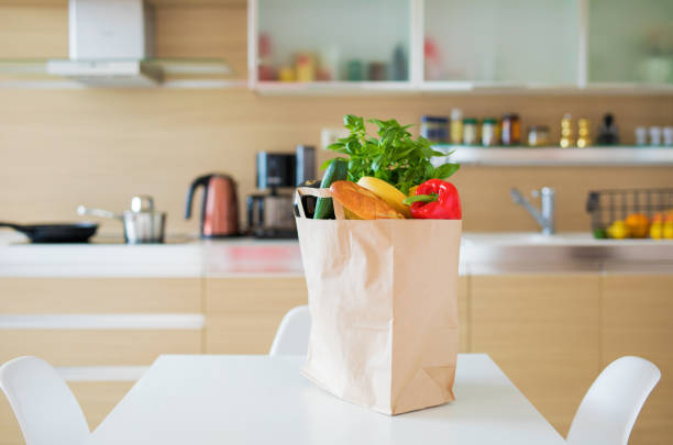 paper shopping bag full with groceries - food delivery стоковые фото и изображения