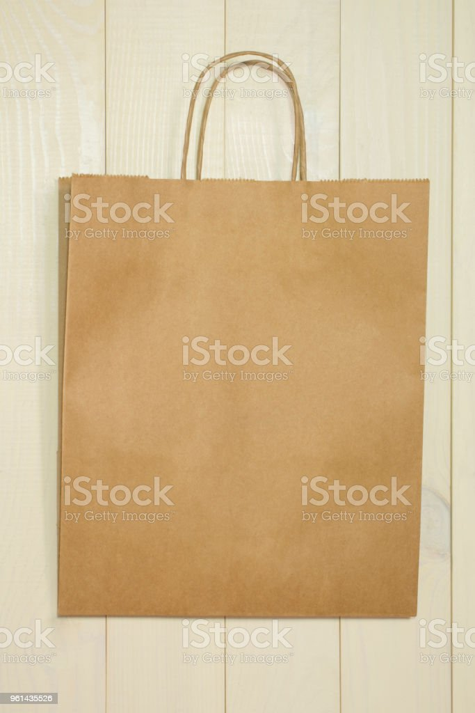 paper shopping bag on a wooden background bag template for design