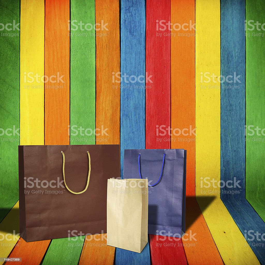 Paper shopping bags on Multi Colored wooden room royalty-free stock photo