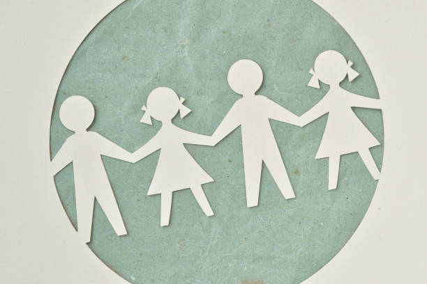 Paper silhouette of children - Ecology and social responsibility concept Paper silhouette cut of children chain - Ecology and social responsibility concept social responsibility stock pictures, royalty-free photos & images